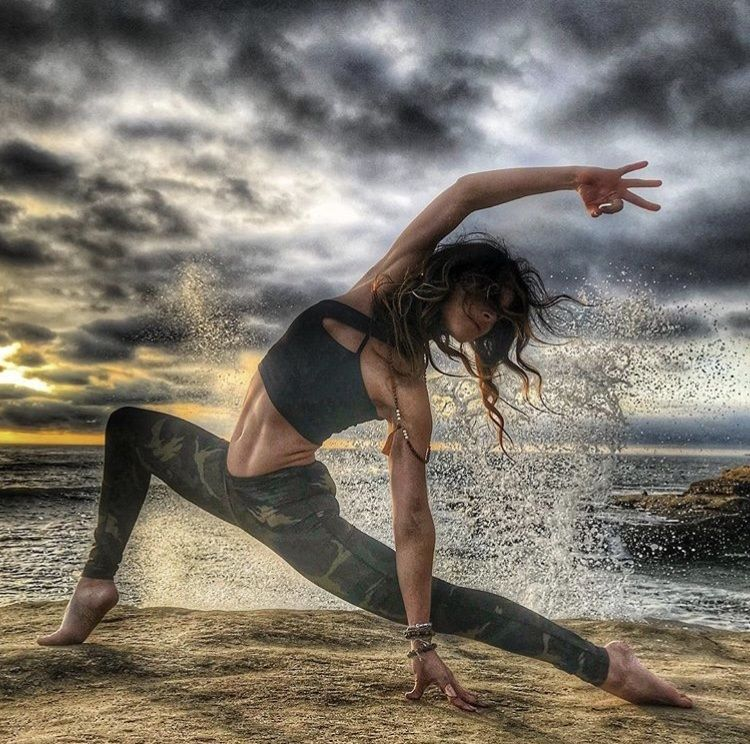 Liz Corwin yoga pose on beach