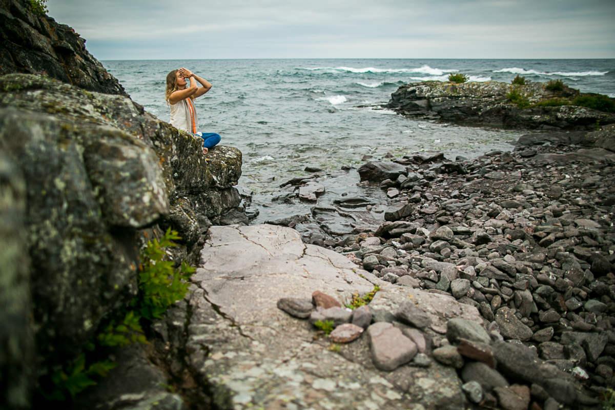 Amie Heeter meditating at Lake Superior