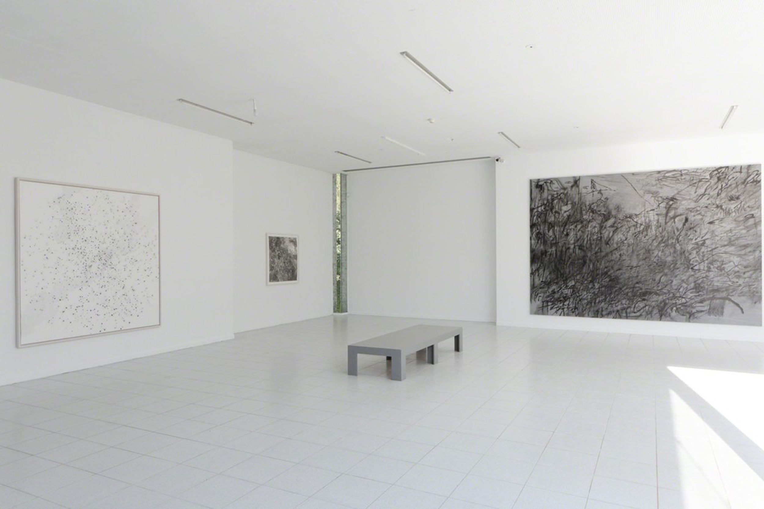 Artworks in the photo, from left to right:  Jessica Rankin, The Great Other, 2016, courtesy of the artist and carlier | gebauer, Berlin Jessica Rankin, Let the Awful Shade Stop Rising, 2014, courtesy of the artist and Salon 94, New York Julie Mehretu, Invisible Sun (algorithm 7, spell form), 2015, courtesy of the artist and Marian Goodman Gallery, New York