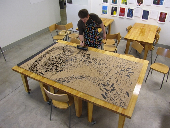 Graham Judd inking a really, really large woodcut