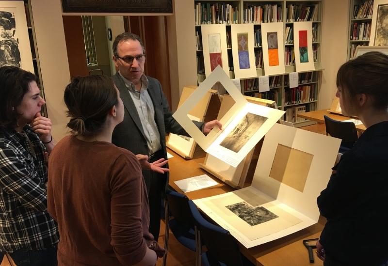 Sam Orosz, Amira Pualwan, and Makenzie Flom visit with Dennis Michael Jon (facing camera), Senior Curator of Prints and Drawings at Mia.