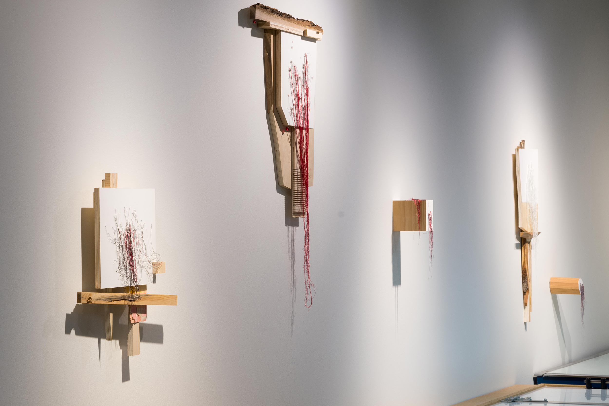 installation view of  Trace Elements , augmented relief prints on wood with glass beads and silk thread