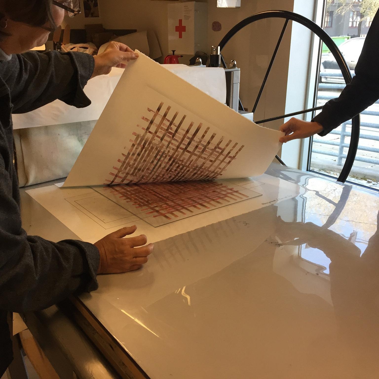 Pulling a monoprint.