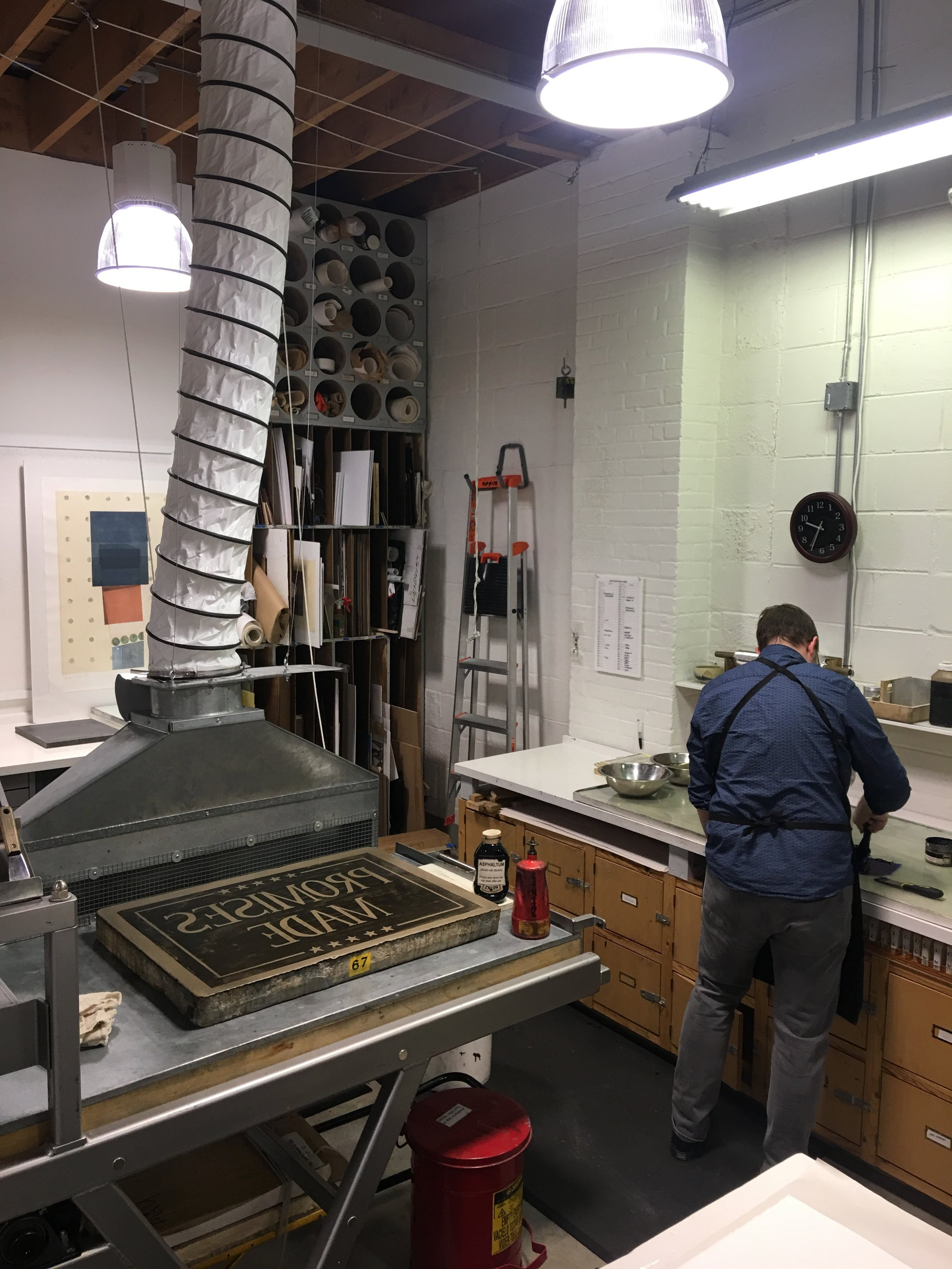 Litho press with retractable ventilation hood