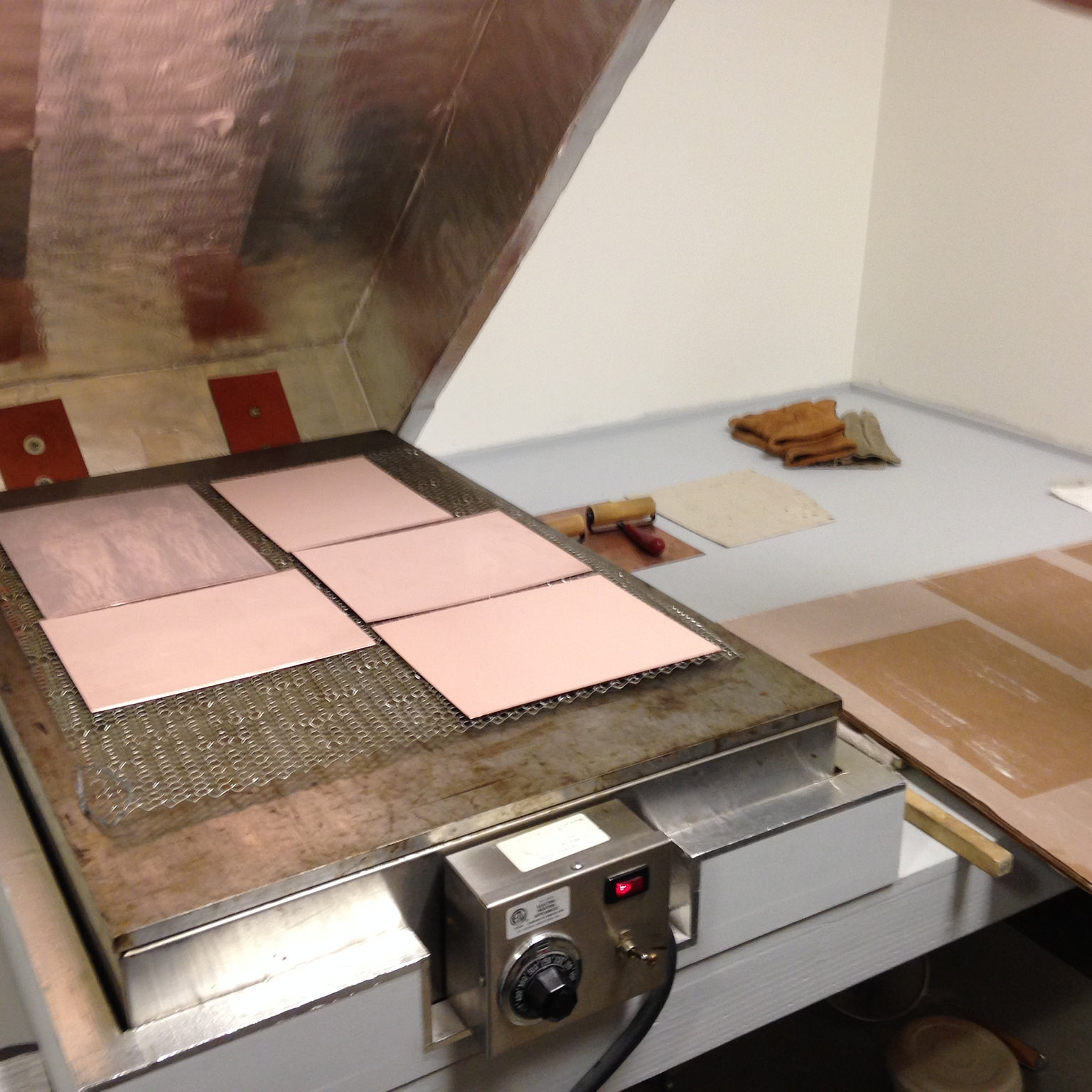 Heating the applied rosin for aquatint.