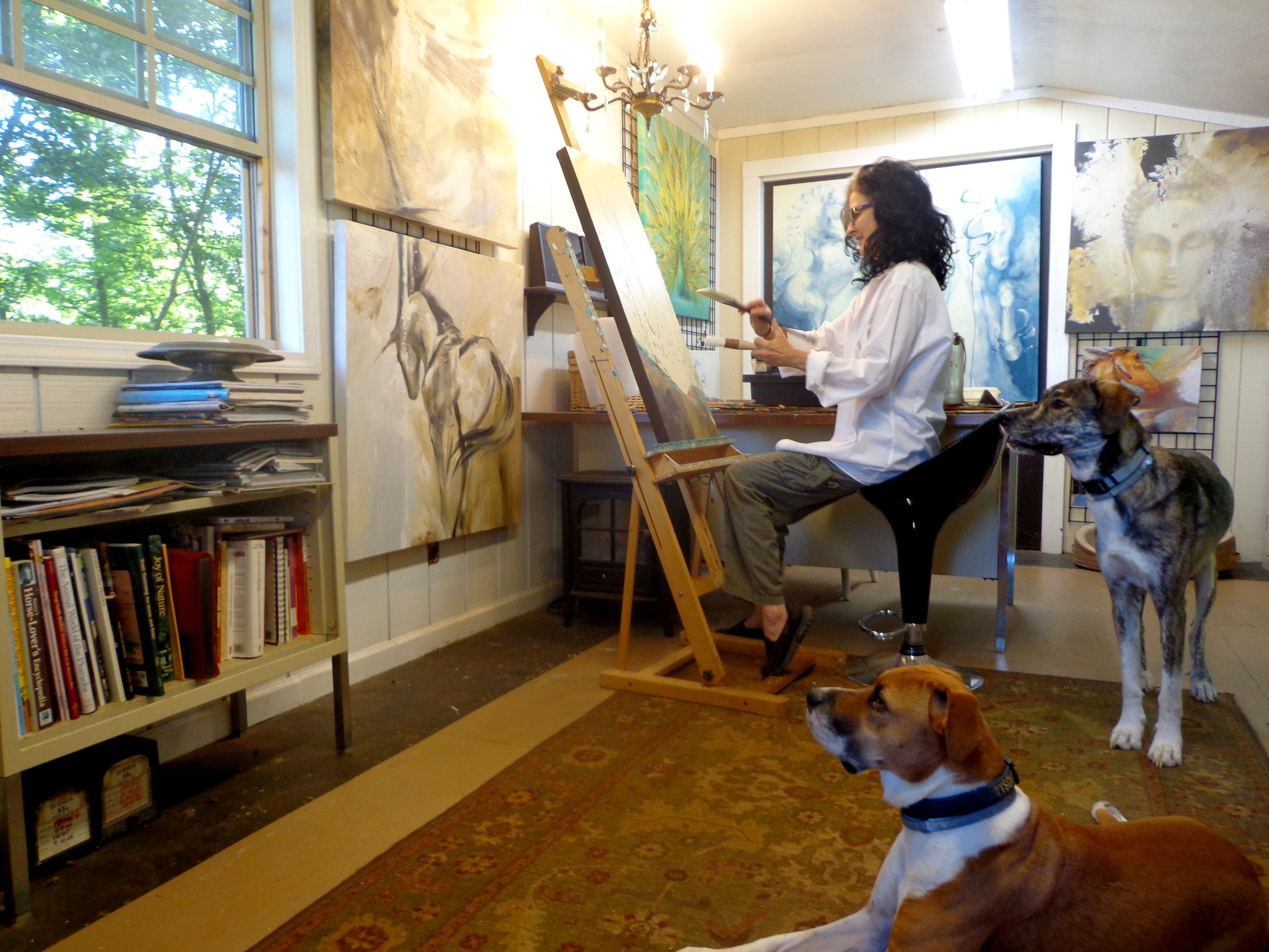 "Dina at the easel, joined by 2 ""studio assistants""."