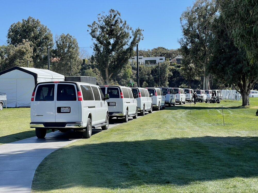 Rain delay evacuation vans on a sunny day