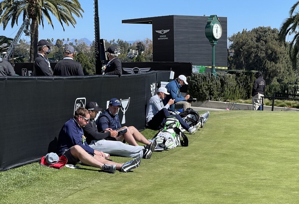 Players and caddies wait out the winds including Francesco Molinari