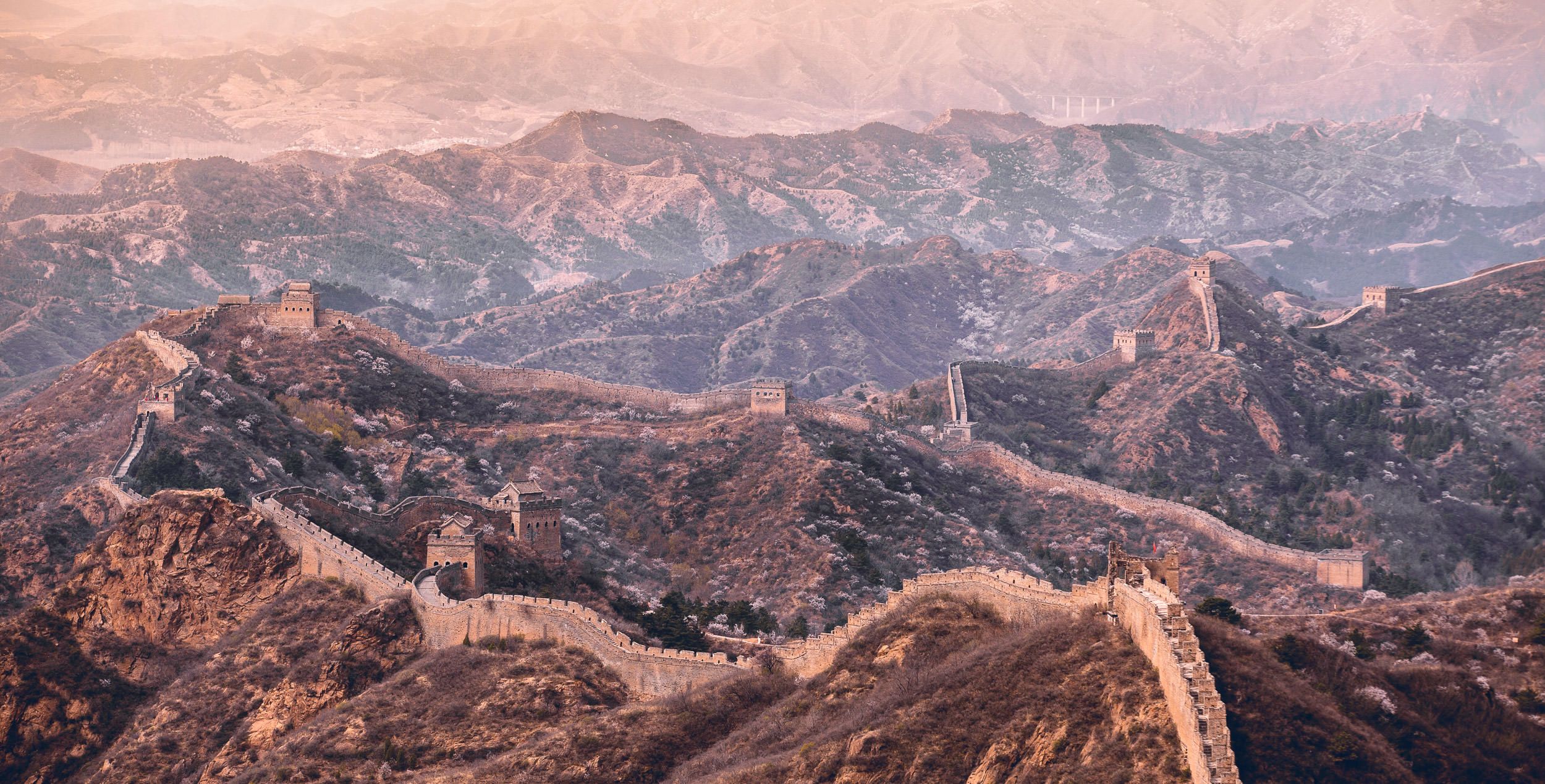 A restored section of the Great Wall of China, Jinshanling, sprawls across the Yan mountains