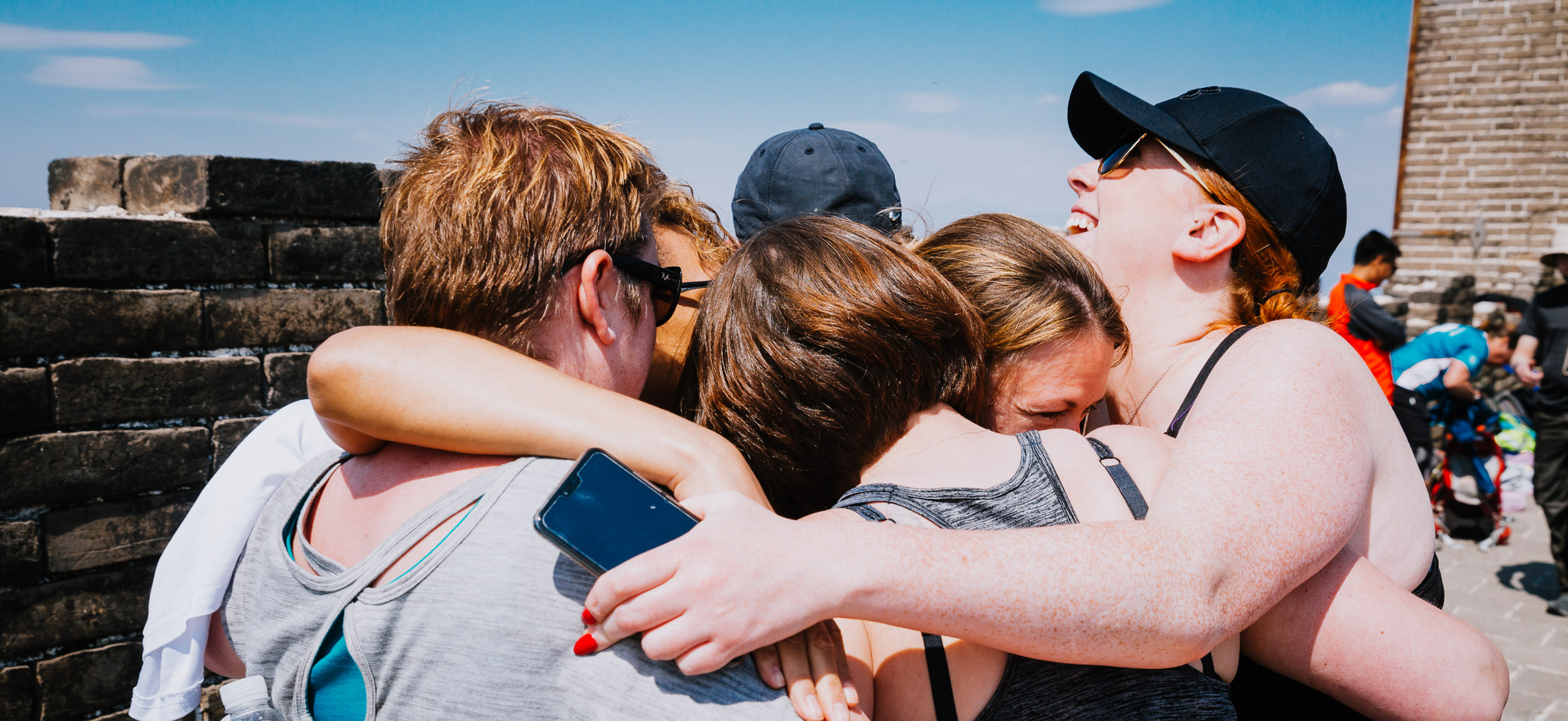 The Charity Challenge Group hugs just before finishing the five day Great Wall Trek