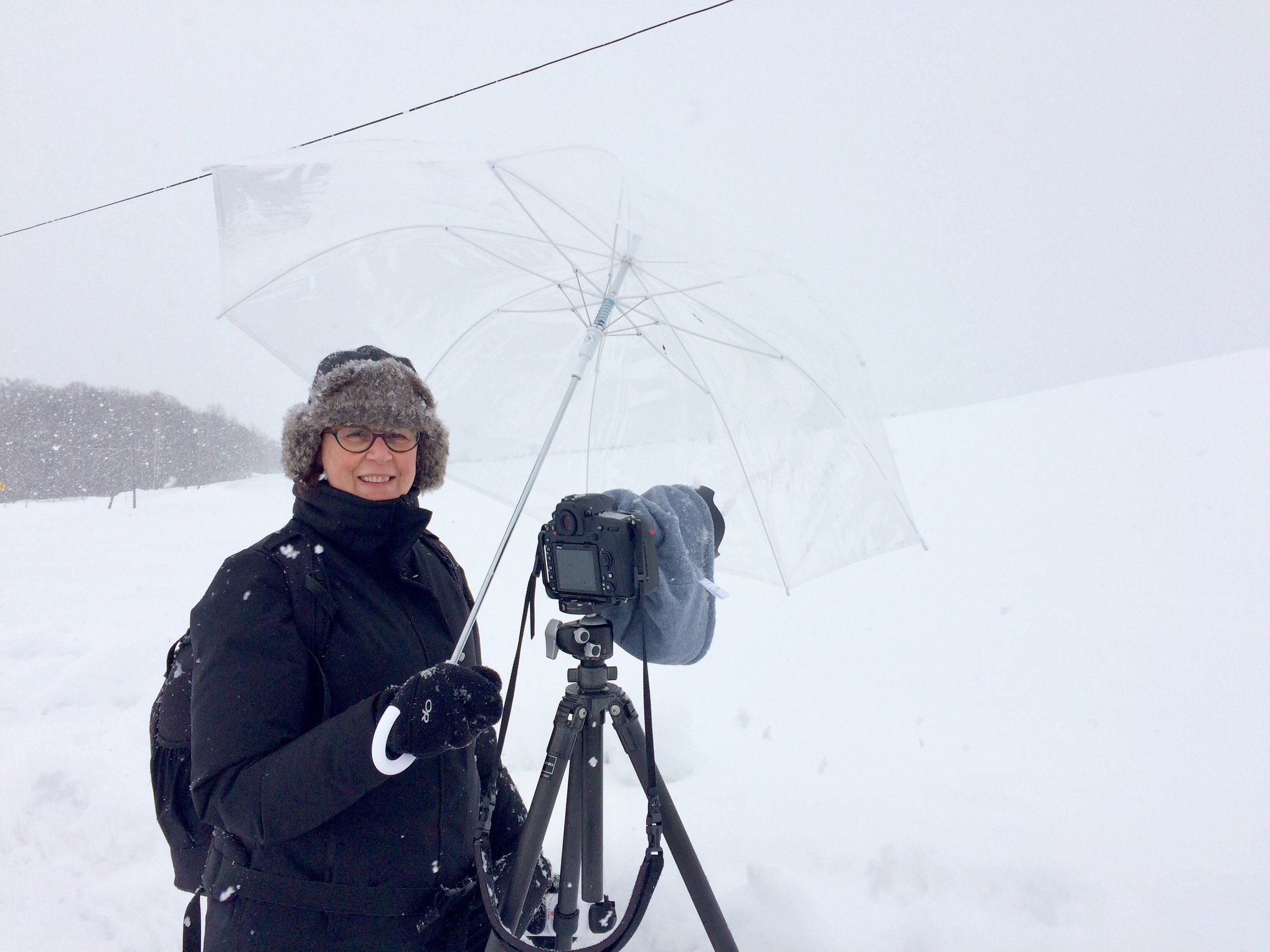 Teamwork: I am holding an umbrella over Ulana's camera in order to keep the blowing snow off her lens.