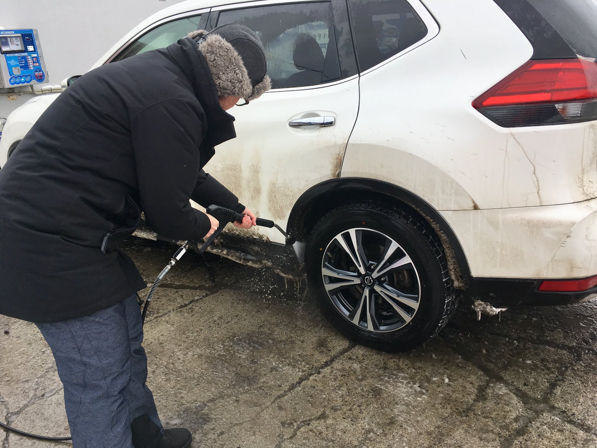 We used this car wash to try and clean out the huge chunks of ice that had formed in the wheel wells. There was so much ice it was only millimeters from the tires.  (photo: Ulana Switucha)