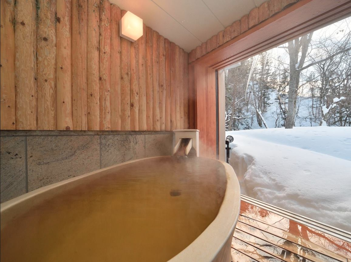 This is one of the private onsen tubs. The hotel has a public onsen, 3 private onsens and then each room has its own. I tried all of them! : )   Imagine this at night. Cameras/phones are prohibited in the onsen, so I took this image from the hotel website.