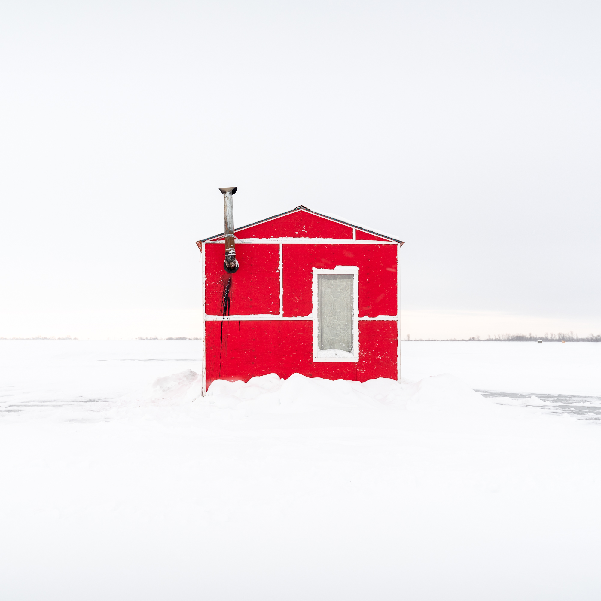 Ice Fishing Huts - An invitation from an old friend to visit Manitoba turns into a great trip to photograph ice fishing huts on Lake Winnipeg.