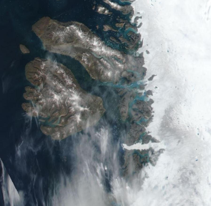 A closeup of Disko Bay from space shows the Jakobshavn glacier and icefjord clearly visible from space.