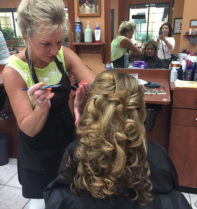 Patti getting the bride ready for her big day! If you need bridal hair done, let us know! We will take care of you! • #hair #hairstyles #updo #bride #bridalhair #wedding #bigday #curls #andreyssalon #beafriendbringafriend