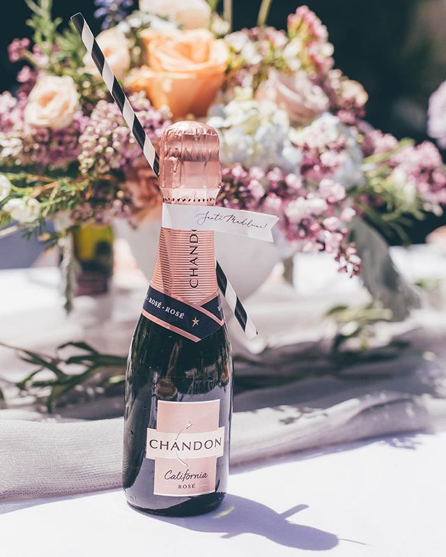 I mean… when is mini Chandon not the cutest?! Just pop the bottle, dip the straw, and you're good to go!  Photo | @ashleystreff  Rentals | @premiere_rents  Linen | @latavolalinen