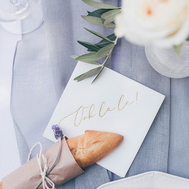 Individually wrapped baguettes and all the ooh la la details!  Photo   @ashleystreff Rentals   @premiere_rents Linen   @latavolalinen