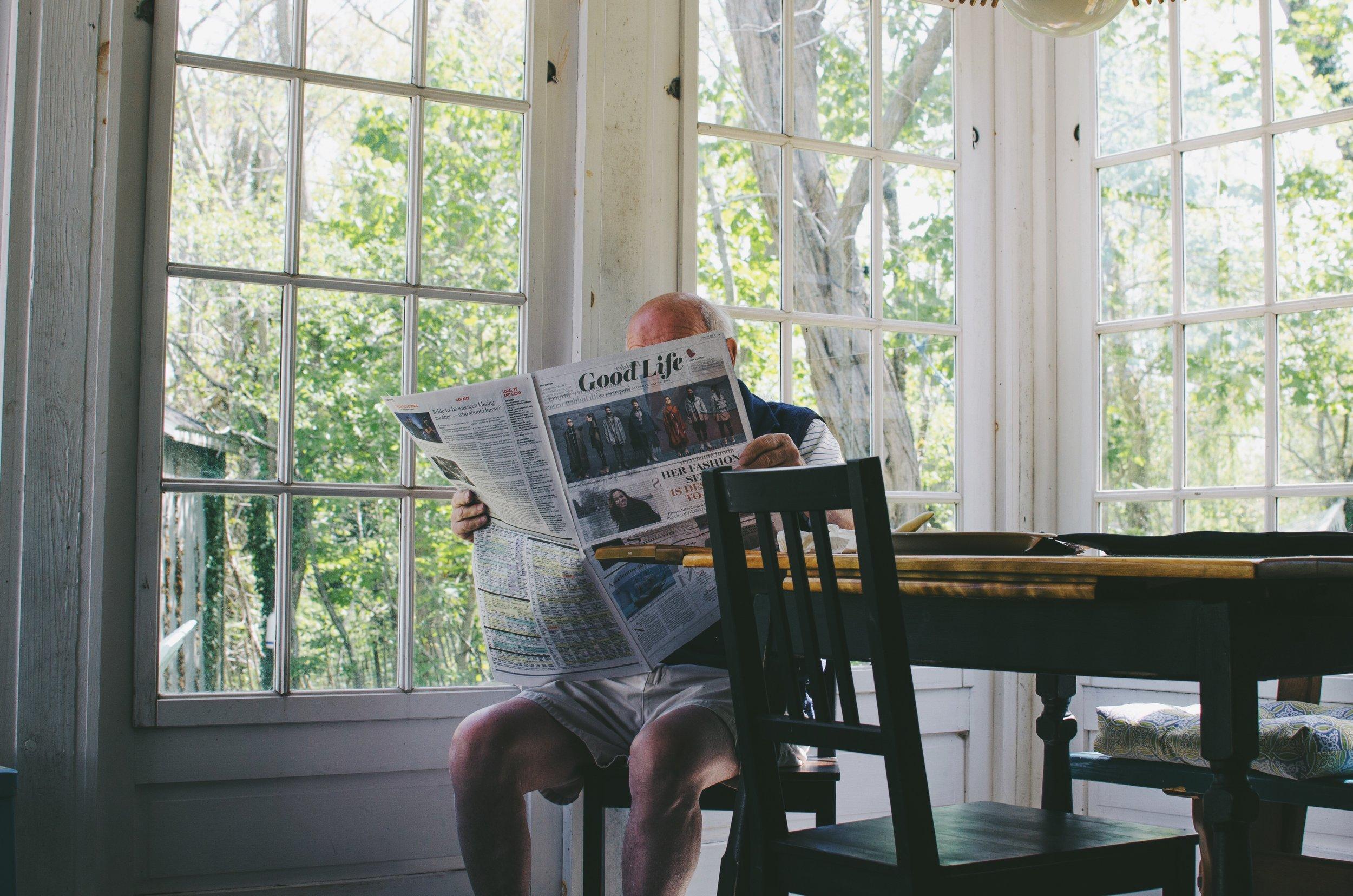 negative-space-old-man-reading-newspaper-morning-sam-wheeler.jpg