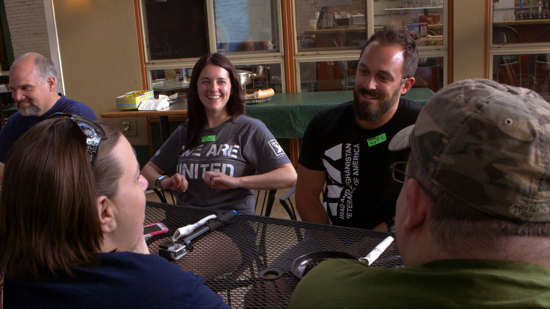 Vets_Smiling_Talking_on_Patio_AmericanCreed_72dpi.jpg