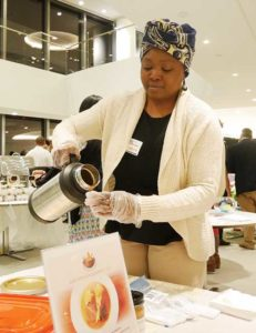 Paulette Ngachoko, Owner of Hapi African Gourmet, pouring Hapi's signature creamy peanut sauce