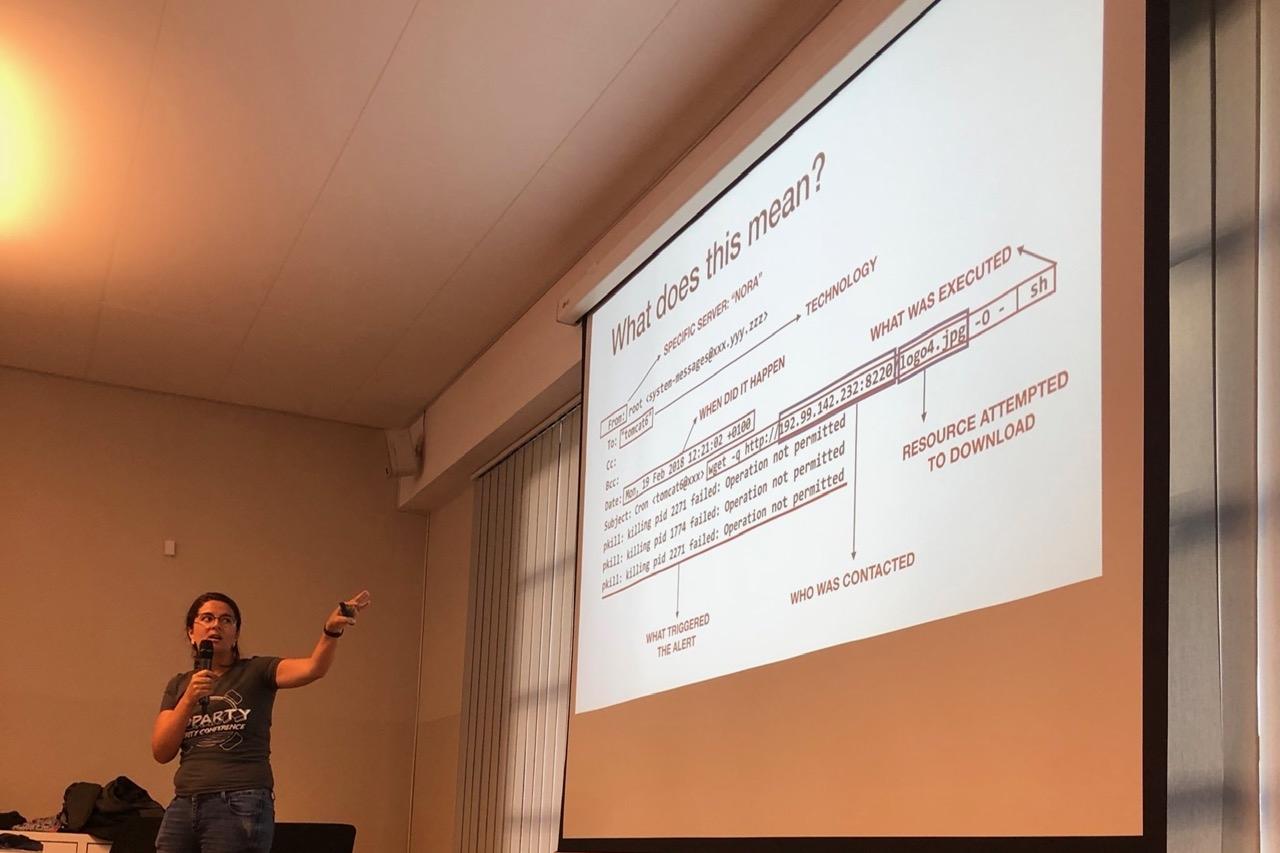"""Veronica presenting """"Linux servers under siege"""" at BlackHoodie 2018."""