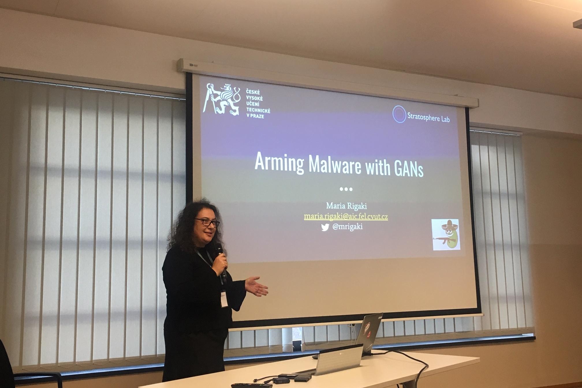 "Maria presenting ""Arming Malware with GANs"" at BlackHoodie 2018."