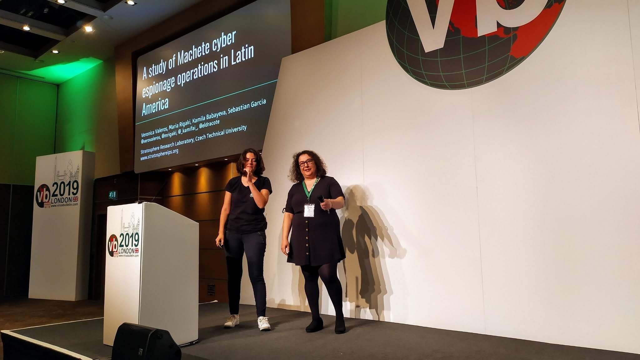 Veronica Valeros (left) and Maria Rigaki (right) presenting the research on Machete at the Virus Bulletin Conference in London.