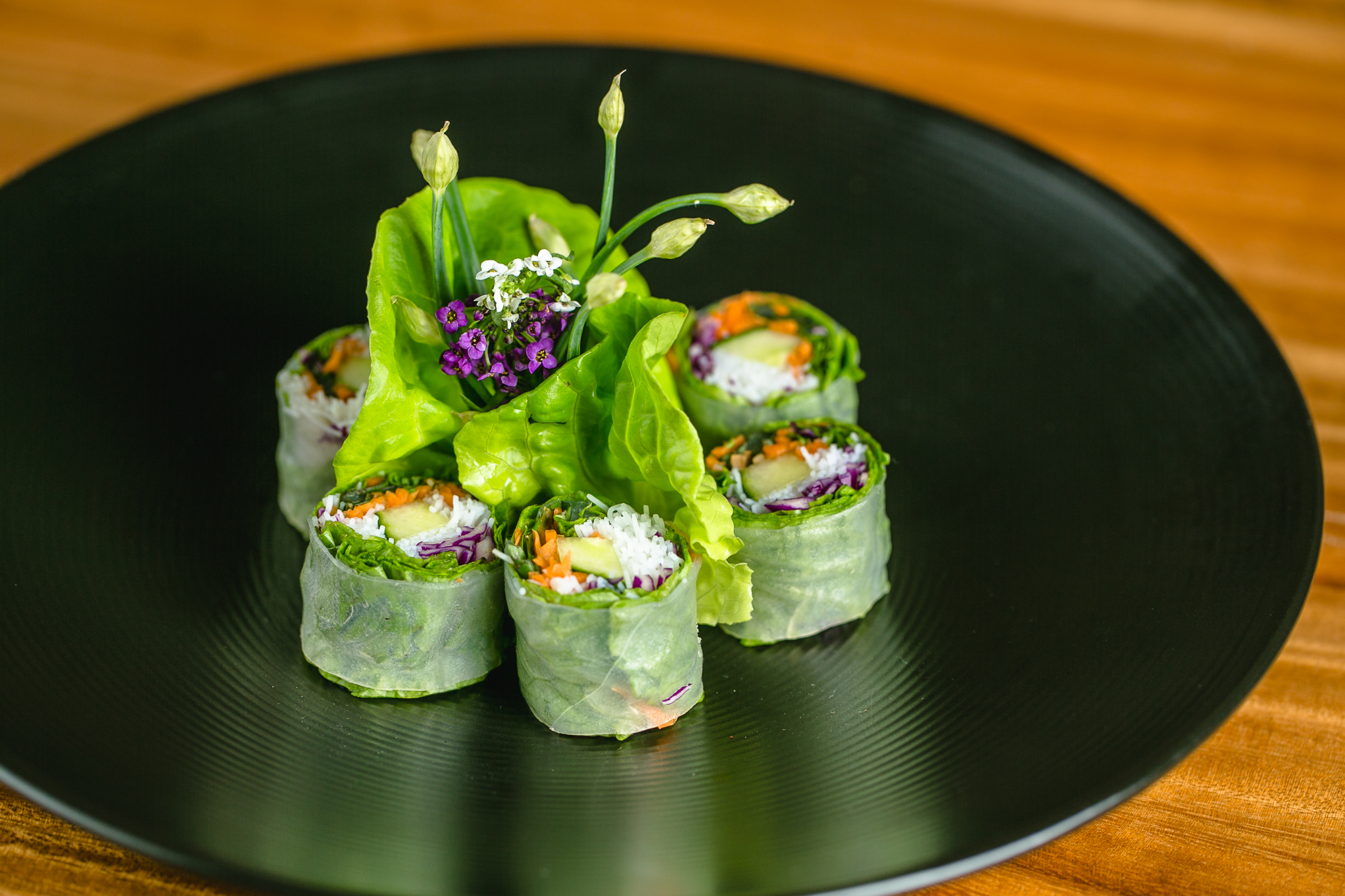 Steamed rice paper filled with basil, cilantro, rice noodles, cucumber, cabbage and scallions, served with honey wasabi lime sauce