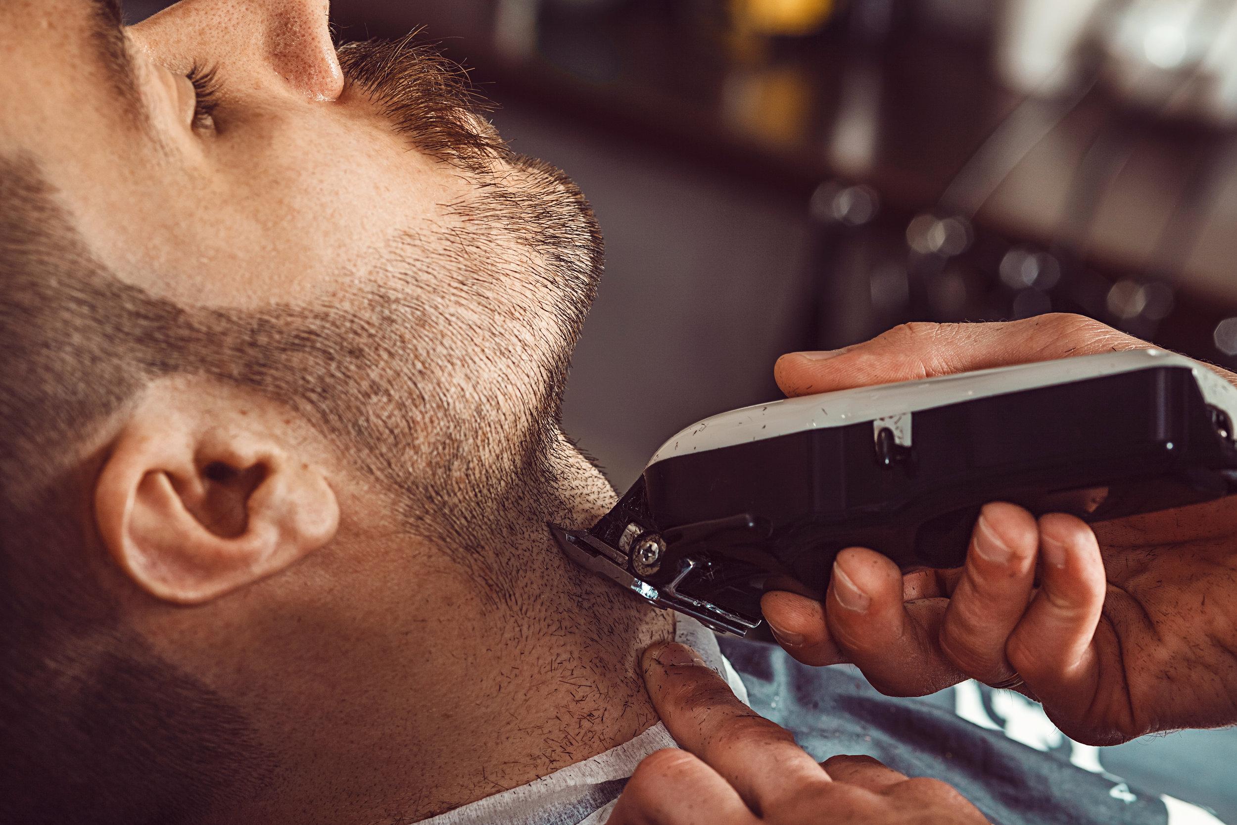 hipster-client-visiting-barber-shop-PMN33U9.JPG