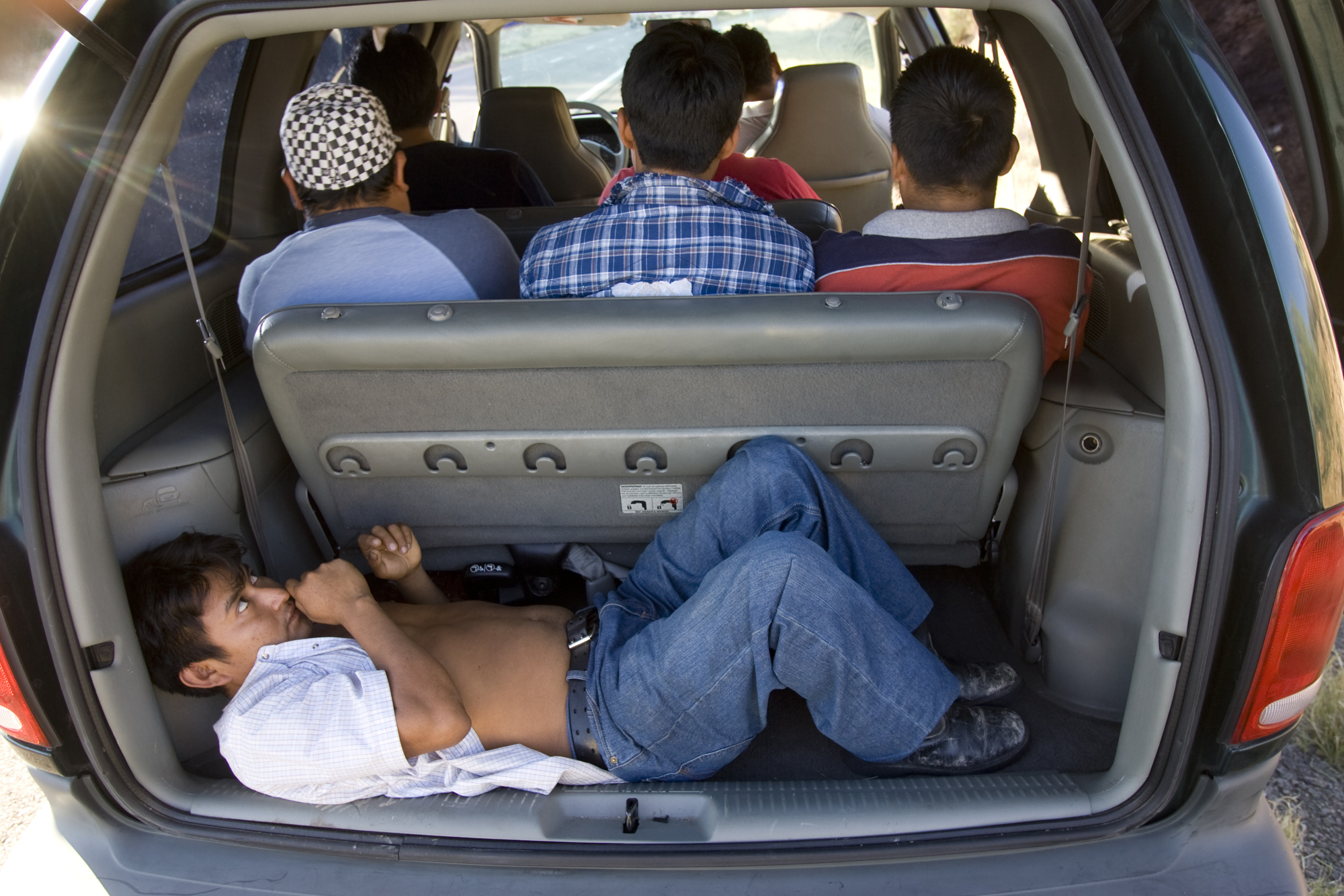 6/3/08- An illigal immigrant lays in the back of a minivan loaded with nine people that was stopped along  I-17.  The group was taken into custody by Maricopa County Sheriff's deputies. (Pat Shannahan/ The Arizona Republic)
