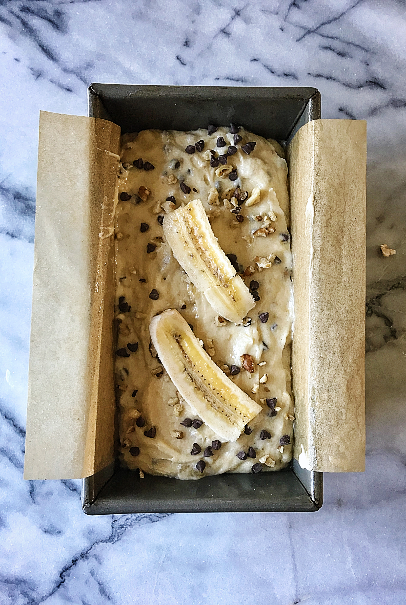 banana cake in pan with toppings.jpg