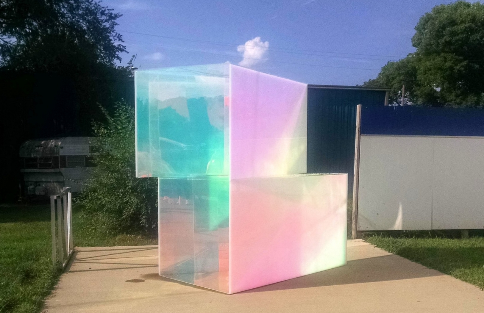 """Special Housing Unit (S.H.U.) by Marcus Manganni  Clear Acrylic, White Acrylic, and Dichroic Film. Installed late July 2018.  """"Best Outdoor Sculpture"""" 2018. Find write-up  HERE .  NOTE: Unfortunately this piece was irreparably damaged late November 2018 and is no longer viewable."""