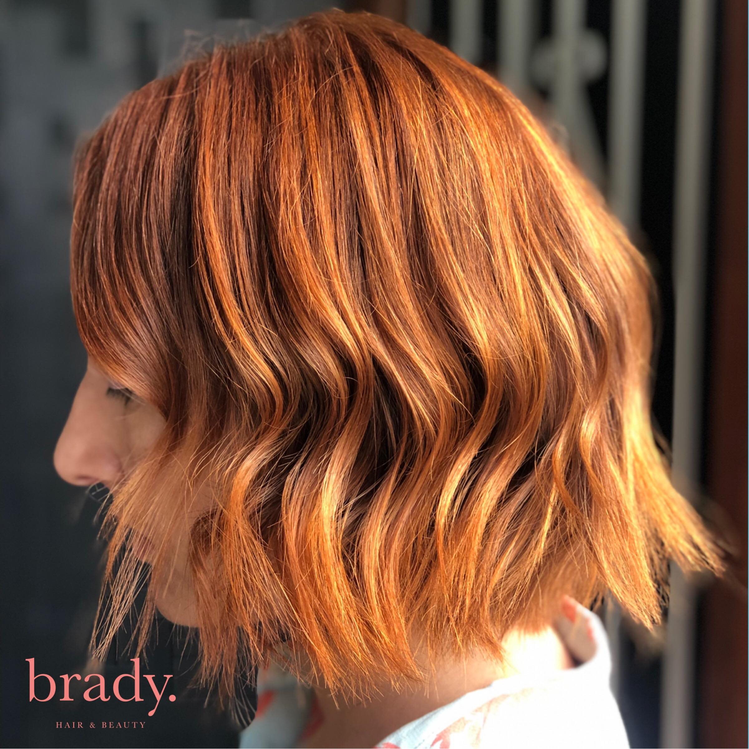 Photo of client with red hair, coloured and styled by Brady. Hair & Beauty, Toowong, Brisbane.