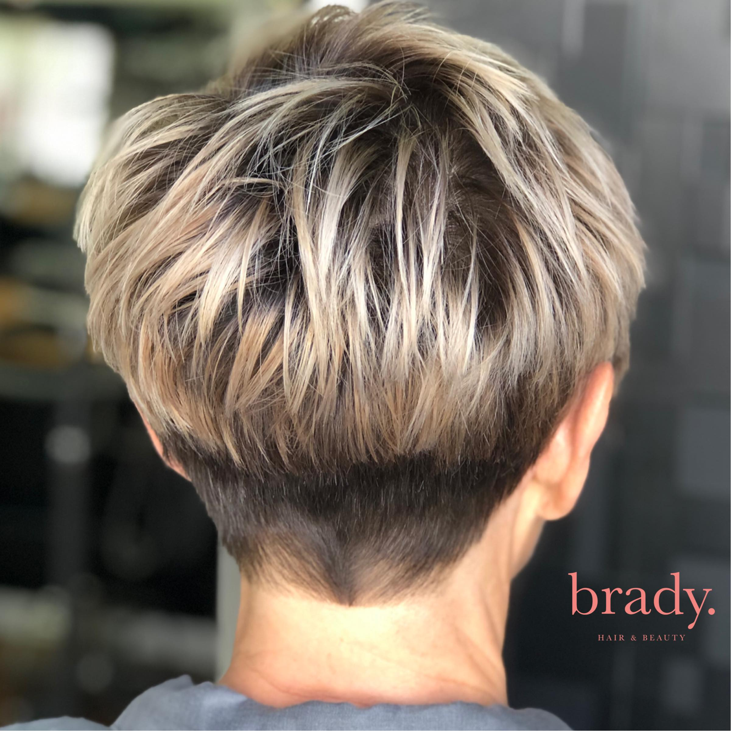 Photo of woman with short pixie style haircut, styled by Brady. Hair & Beauty, Toowong, Brisbane.