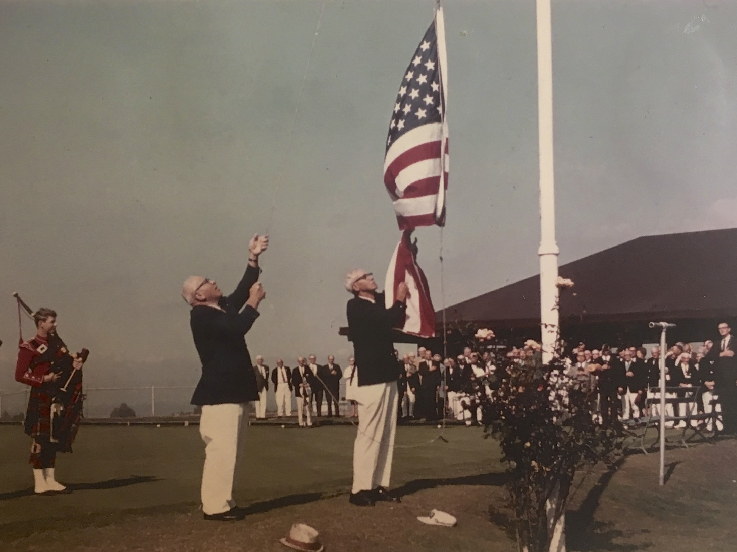 Flag-raising and bagpipes