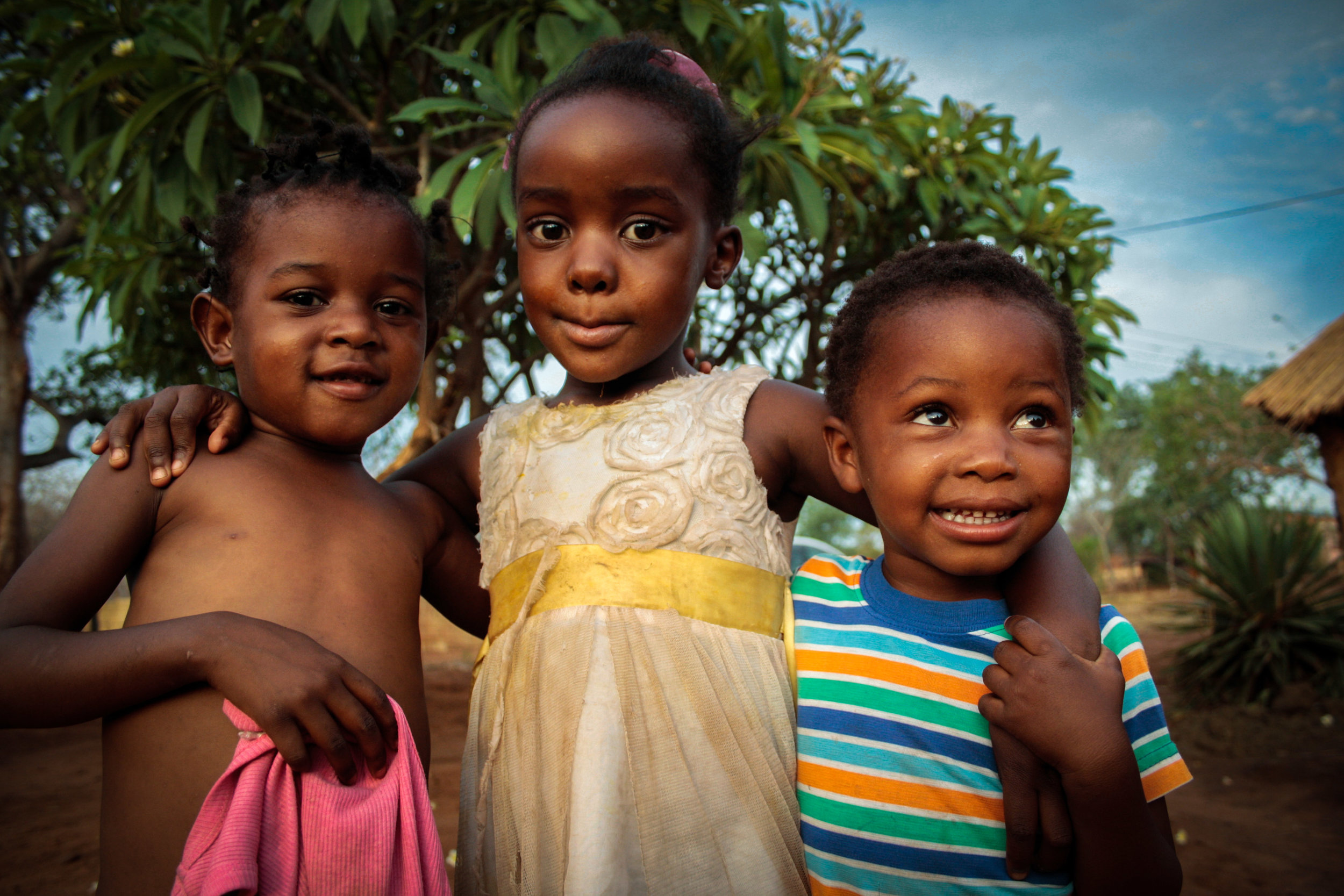 zambia 2016   the children in a family where i was invited for lunch in a small village nearby livingstone. after doing shopping together in the village, we prepared lunch together with the parents of these children, while they were running around and playing with the dogs.