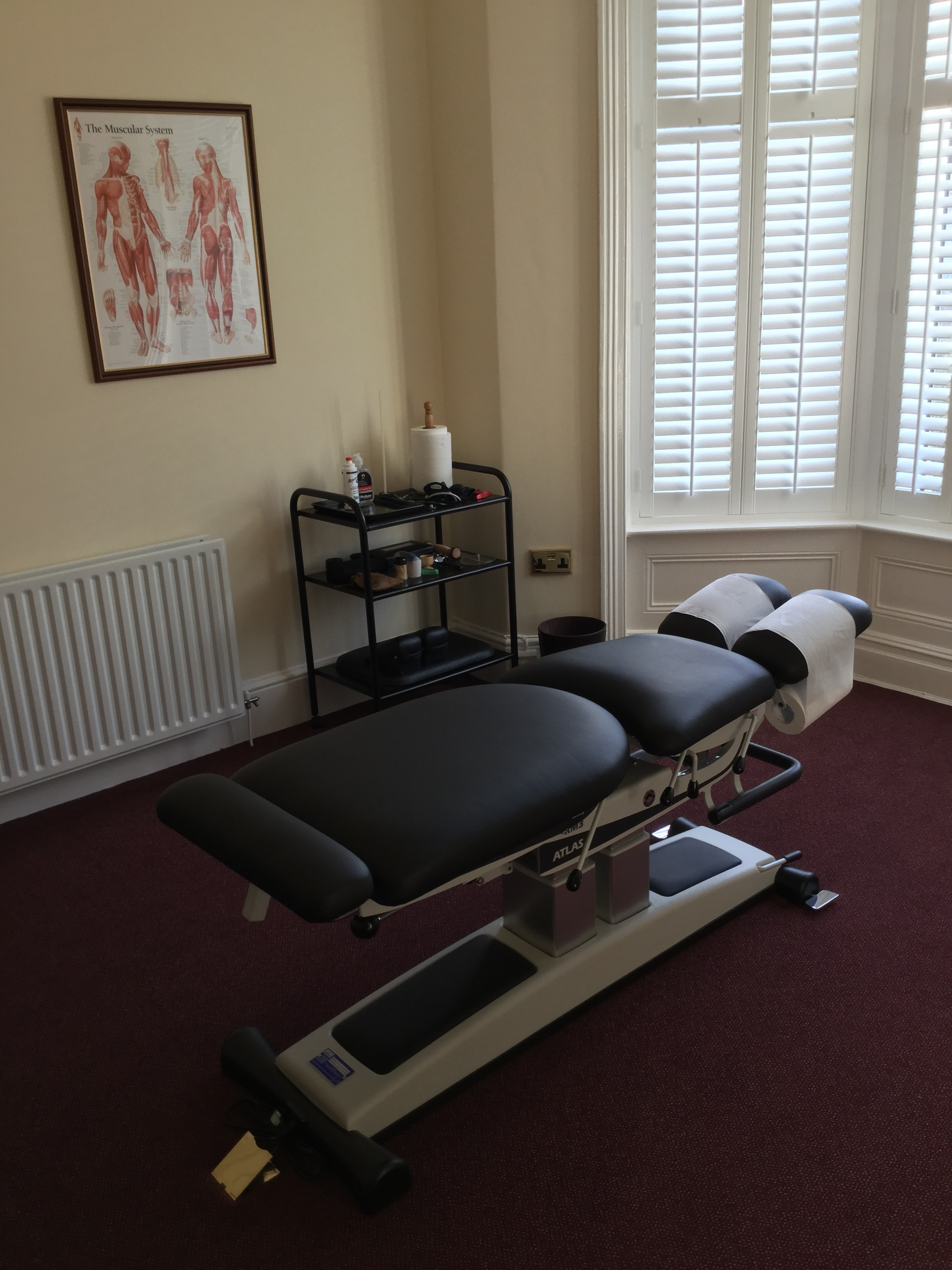 Consultation room showing chiropractic table