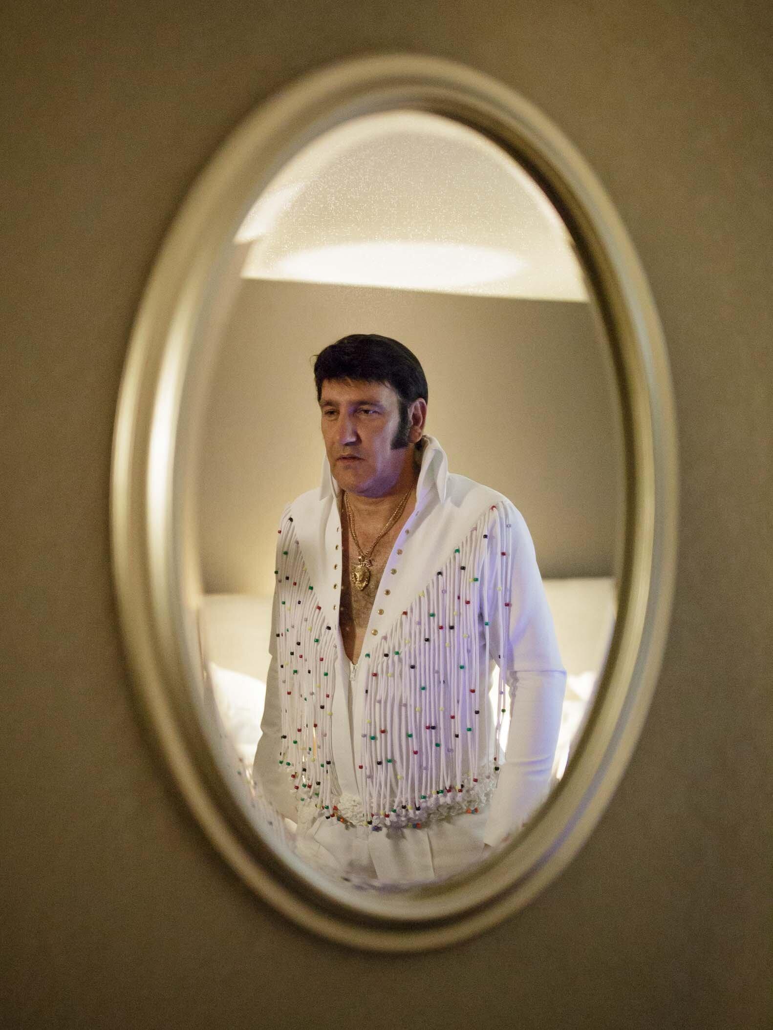 John in his hotel room