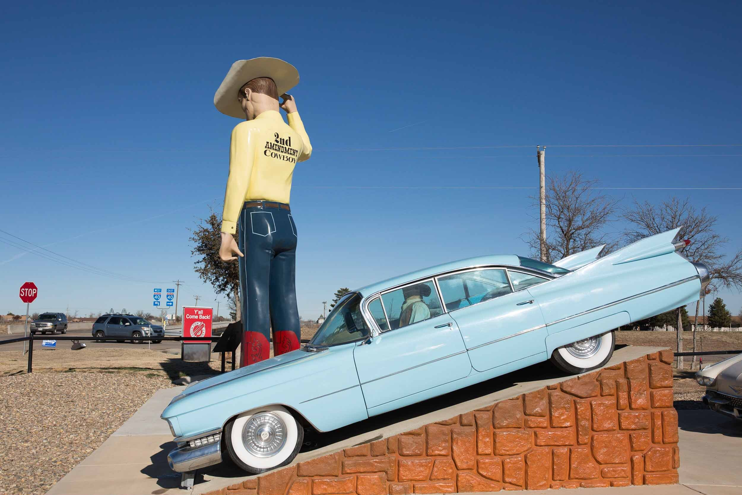 The 2nd Amendment Cowboy muffler man stands tall on Route 66 in Amarillo, TX