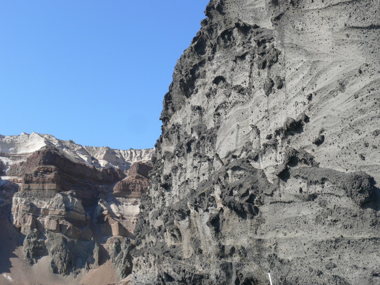 Layers of volcanic ash and pumice from multiple eruptions on Santorini