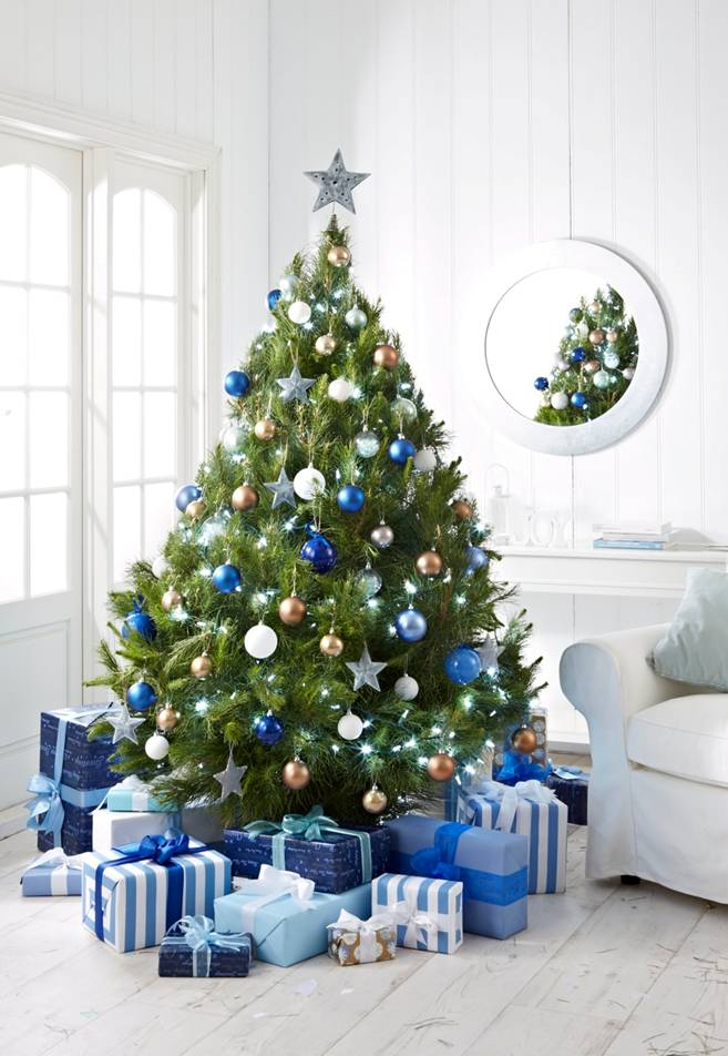 An amazing Merlino's cut Christmas tree featured in a photoshoot for Master's Home Improvement.