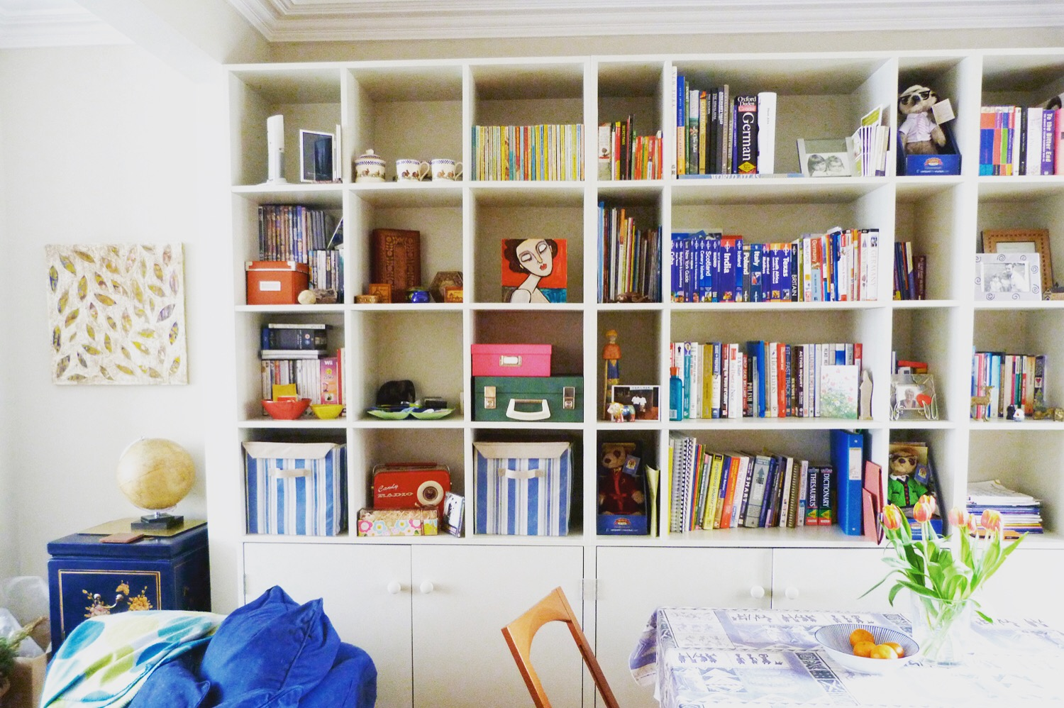 Bookshelves and display shelving - full width box shelving with low-level cabinets painted finish to match decor.