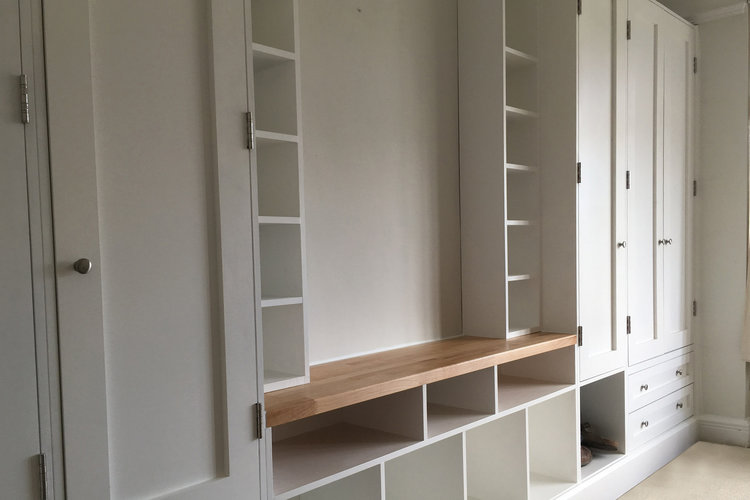 Floor to ceiling bespoke fitted wardrobes.