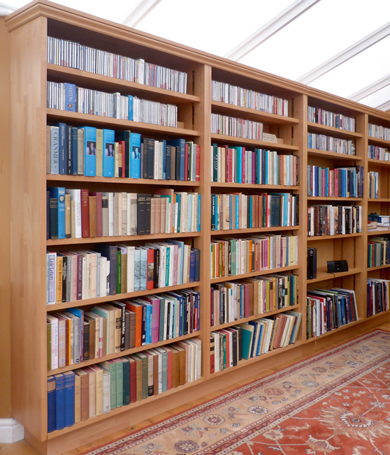 A large bespoke bookcase made out of beech with adjustable shelf heights.