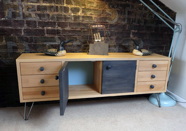 A bespoke made Cube unit with doors and draws.