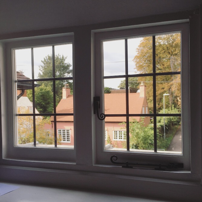 New double-glazed leaded windows made to match original.