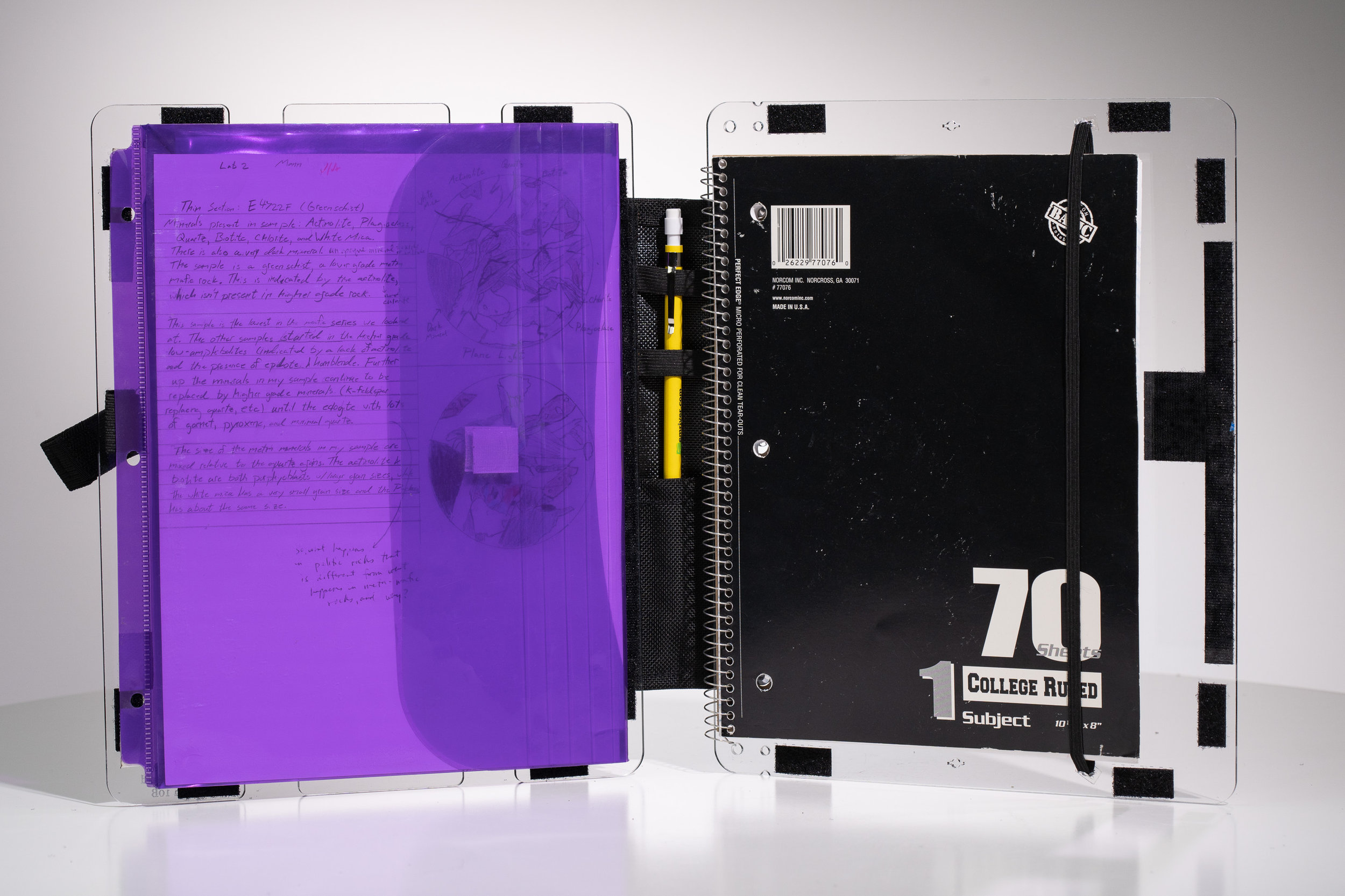 Above and below: A binder pocket with hook adhesive on the back and a notebook held in with screw posts through the back panel.