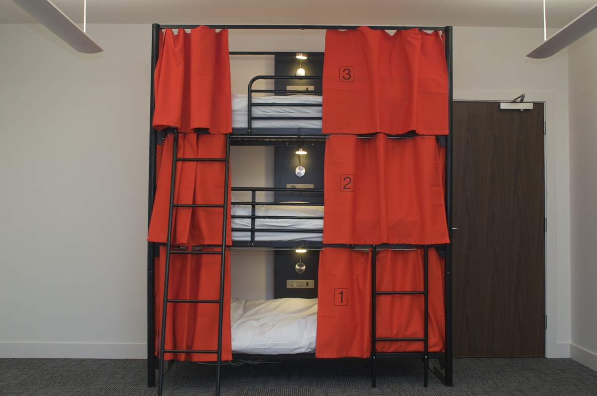 Triple bunk with privacy curtains.JPG
