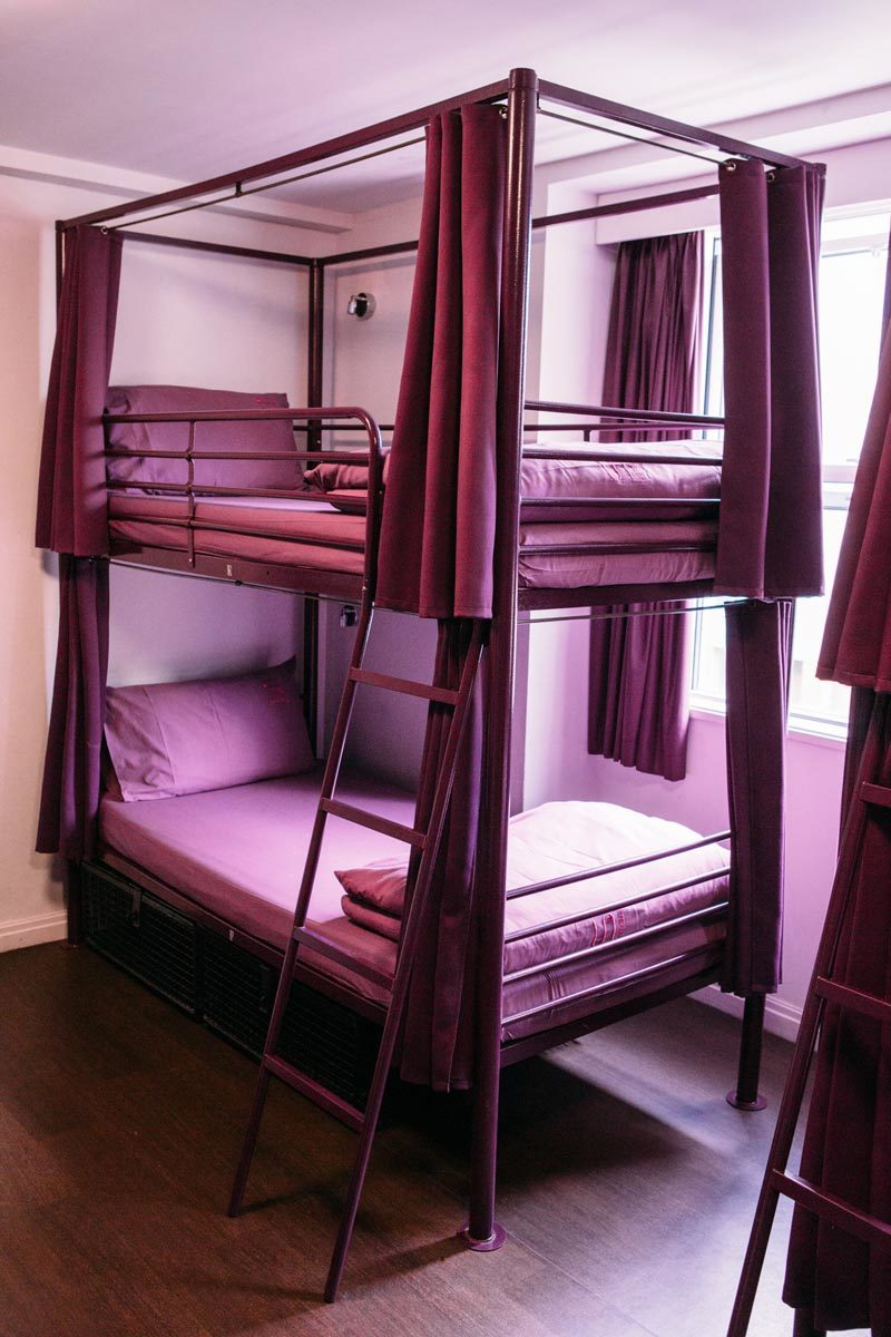 Hostel bunk with curtains.jpg